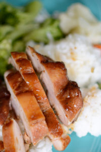 Chicken teriyaki on top of white rice. Meal planning
